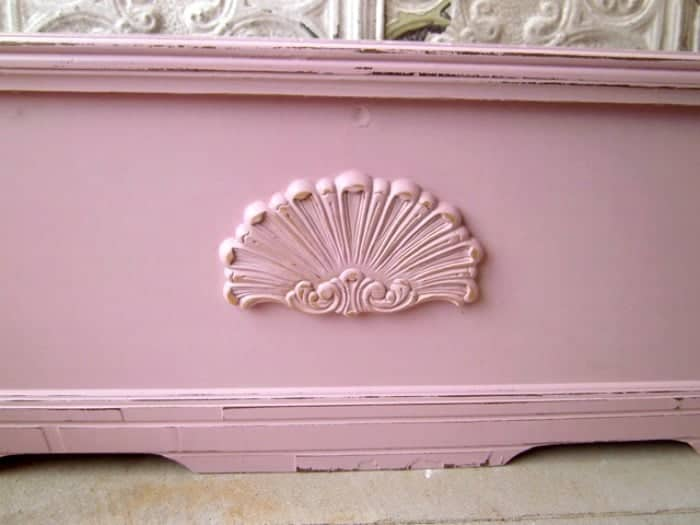 pink wood applique on painted cedar chest