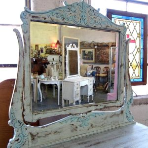 mix two shades of turquoise to paint detailed wood furniture