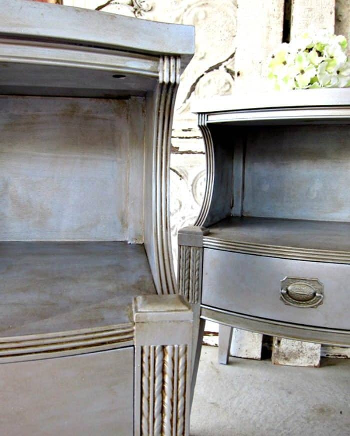 pair of nightstands painted with silver metallic paint and aged with toner