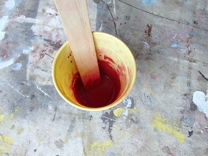 mixing up milk paint in Tricycle red