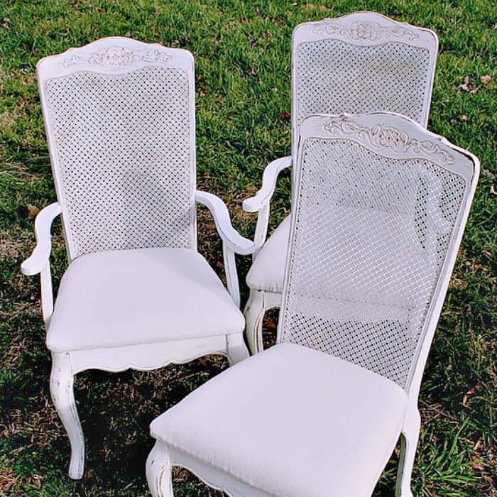 white shabby chic distressed chairs and drop cloth seats