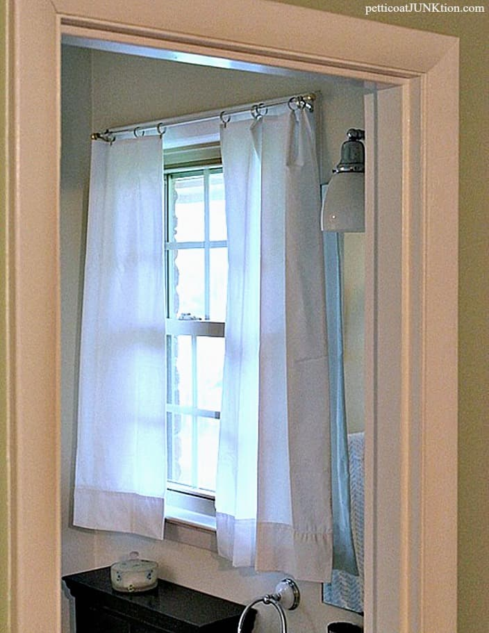 white pillowcase curtains straight from the package hang with metal curtain clips Petticoat Junktion