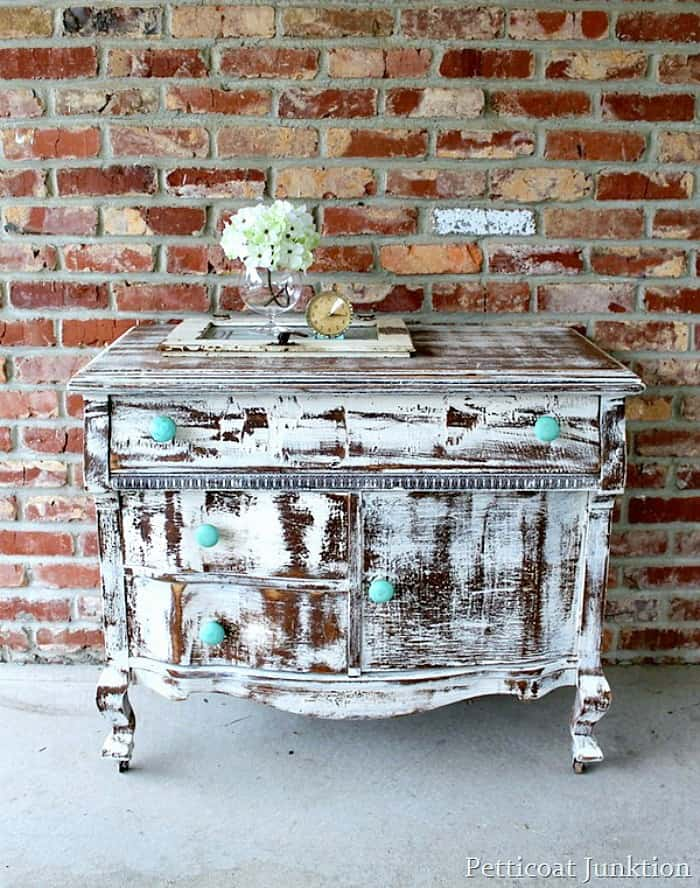 distressed shabby white dresser with turquoise knobs Petticoat Junktion project 1