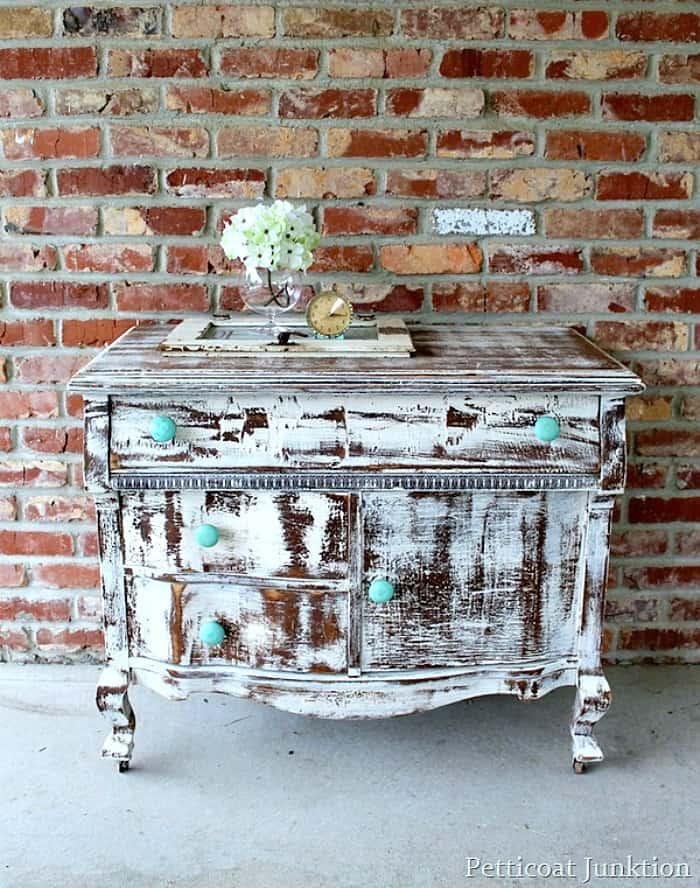 distressed shabby white dresser with turquoise knobs Petticoat Junktion project
