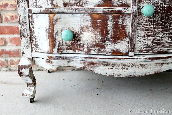heavily distressed white furniture