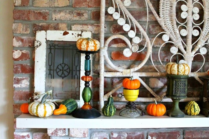 how to decorate the mantel for Fall with gourds and pumpkins