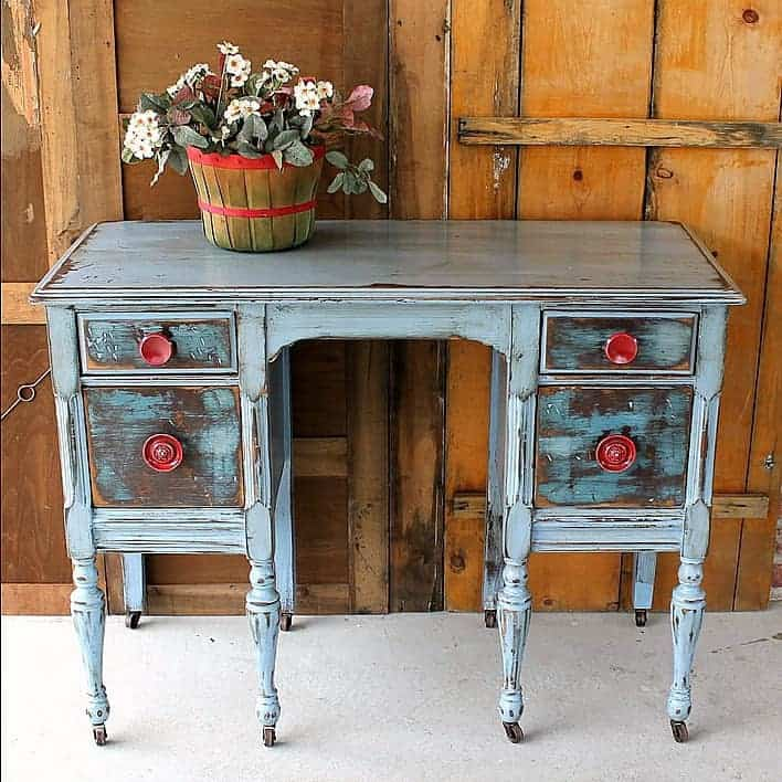 A Furniture: Distressed Furniture With Red Knobs