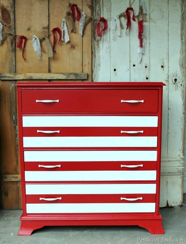 red and white painted chest
