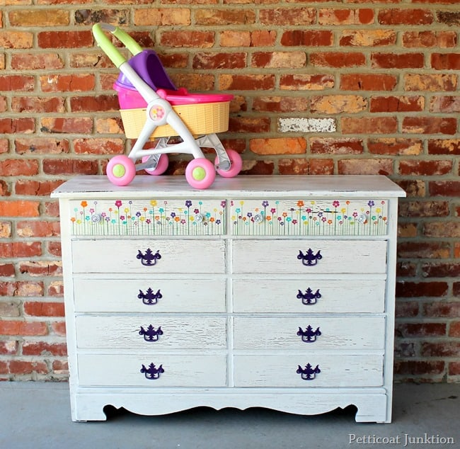 white dresser with colorful stenciled flowers