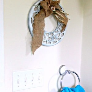 White Metal Trivet And Burlap Wreath