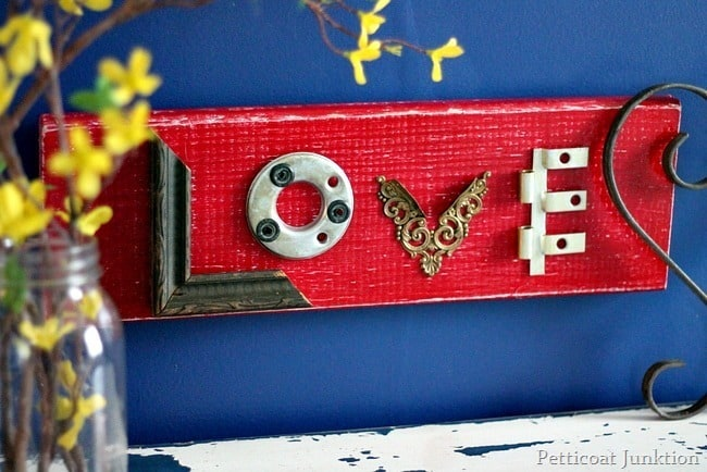 Make this red love wall decor diy craft from things found in your junk drawer or garage.