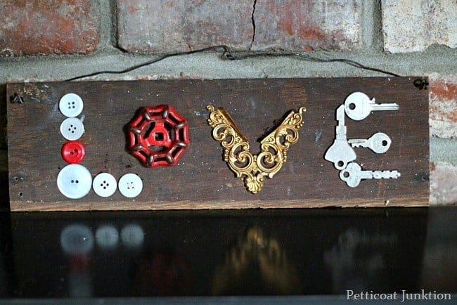 Make A Love Sign With Recycled Buttons And Keys