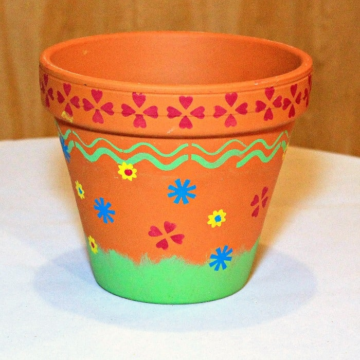 Terra Cotta Flower Pot Decorated With Painted Stenciled Flowers