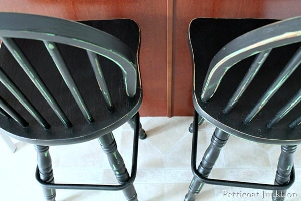 distressed black and green bar stools