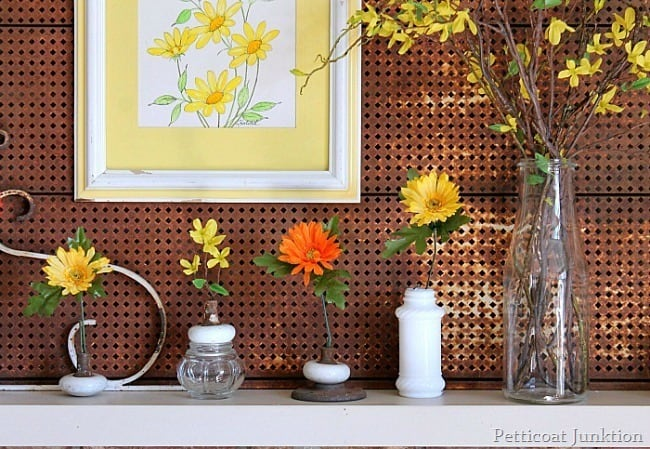 rusty metal and flowers decorate a Spring mantel