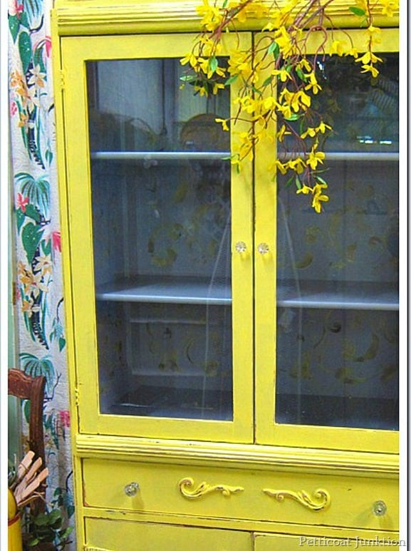 yellow stenciled cabinet