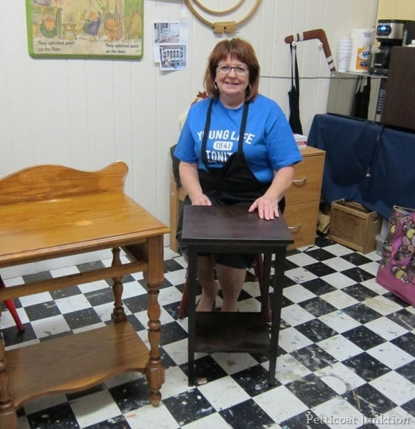 Lynn and her table at the petticoat junktion painting furniture workshop
