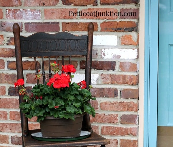 diy chair planter with red geraniums petticoat junktion