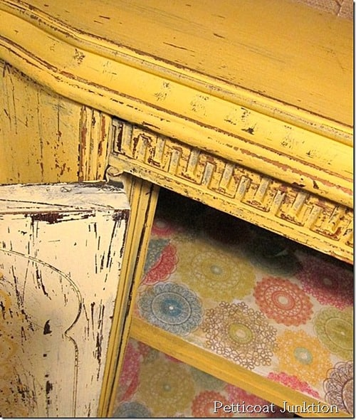 yellow furniture project with scrap book shelf liner