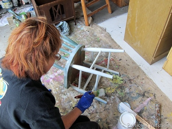 Kathy Petticoat Junktion painting a chair