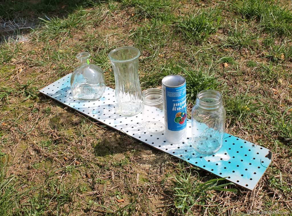 Spray paint glass jars and use them as vases for Paint to use on glass