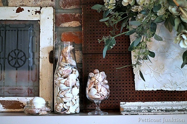white mantel display with seashells Petticoat Junktion