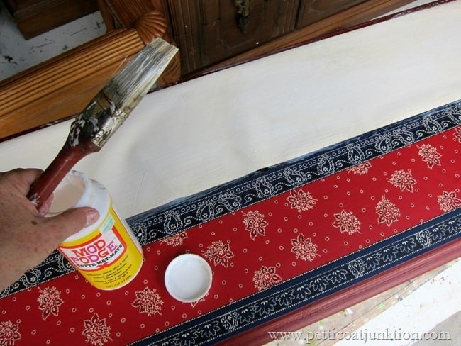 applying Mod Podge for decoupage project Petticoat Junktion