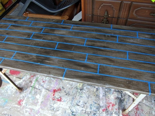 tabletop taped off with painters tape for fake planks