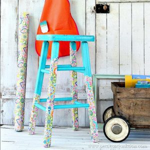 turquoise-stool-with-decoupaged-wrapping-paper-legs