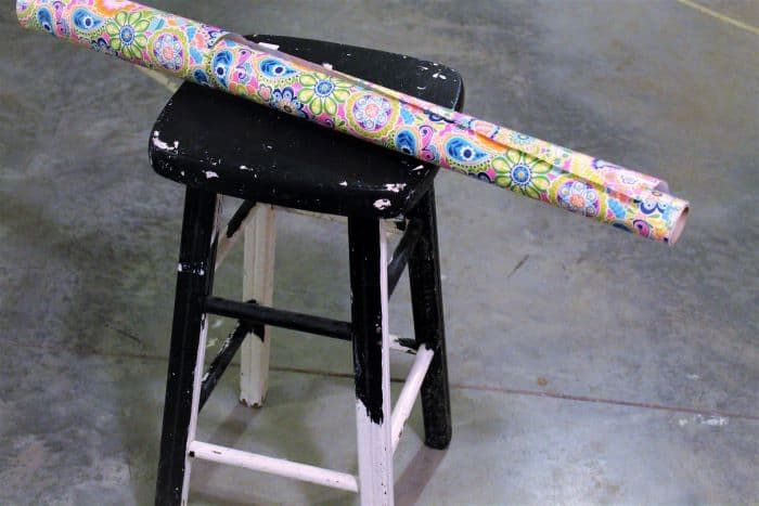 how to decoupage a bar stool with paper using Mod-Podge