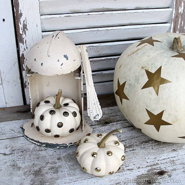 Decorating small white pumpkins using upholstery tacks White pumpkin carving ideas