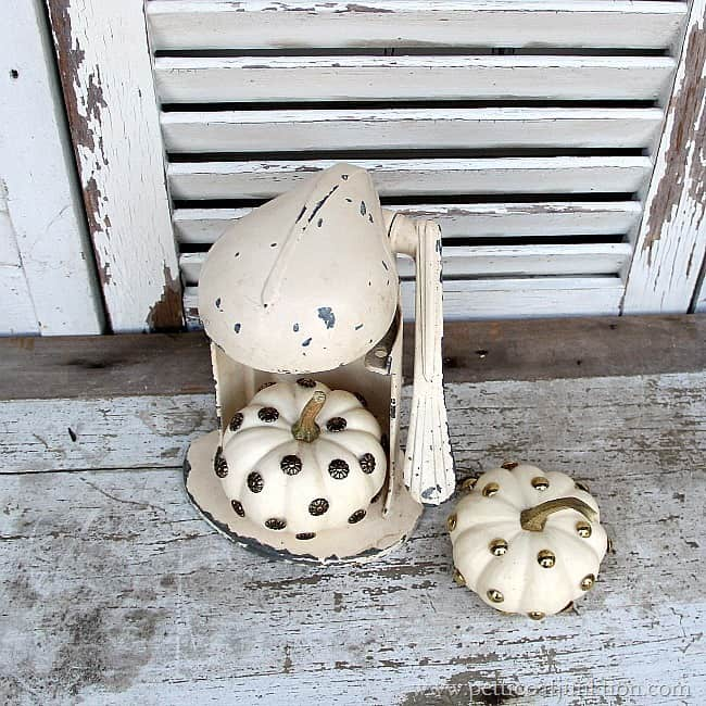 decorating small white pumpkins with upholstery tacks Petticoat Junktion