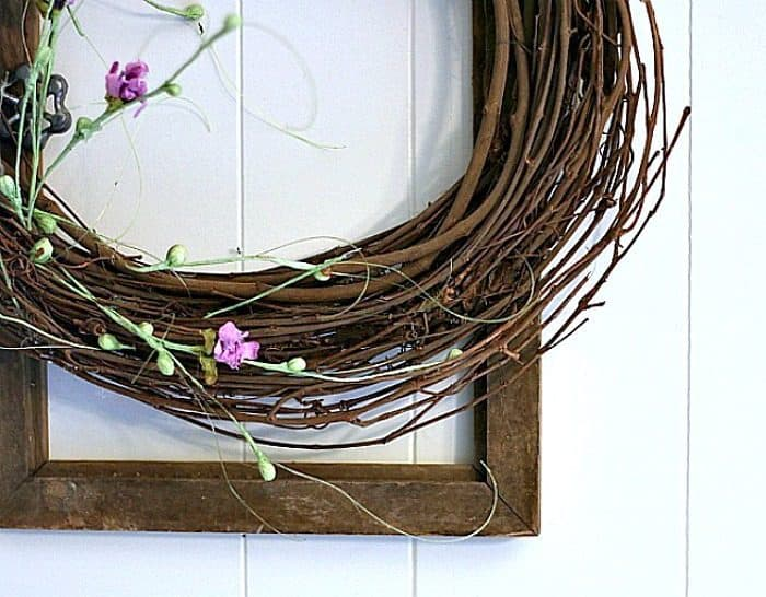 grapevine wreath with purple flowers