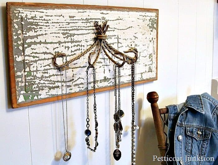 a close up look at the necklace hanger made from reclaimed pieces