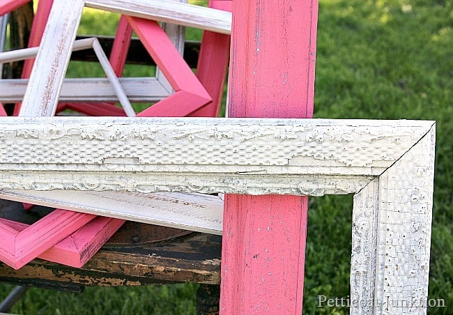 spray paint picture frames coral and white Petticoat Junktion