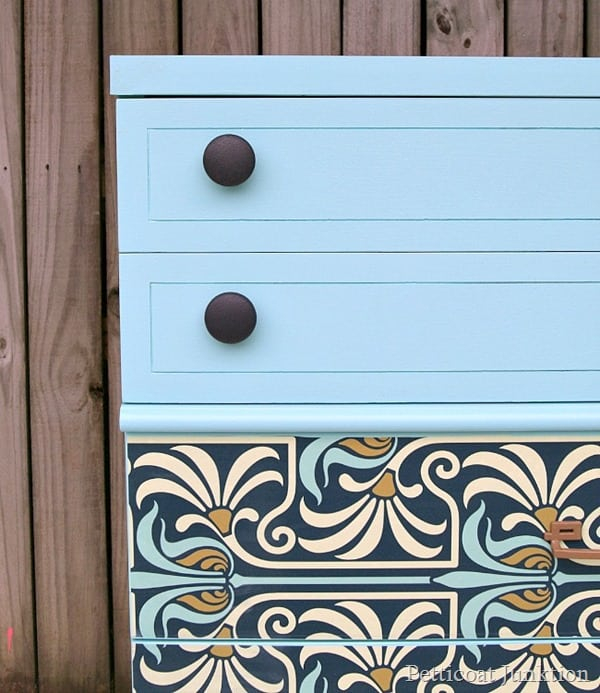 turquoise wallpaper on furniture