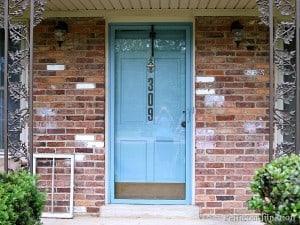 painted metal storm door and front door