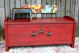 antiqued-red-cedar-chest-adorned-with-iron-stars-Petticoat-Junktion_thumb.jpg