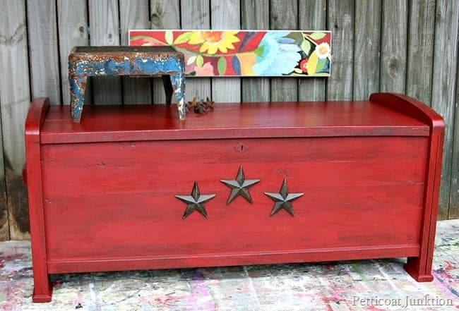 antiqued red cedar chest adorned with iron stars Petticoat Junktion