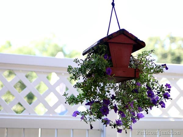 red painted bird feeder becomes hanging flower plainter Petticoat Junktion