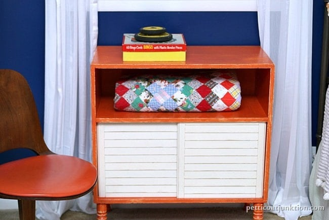 orange furniture and blue walls Petticoat Junktion