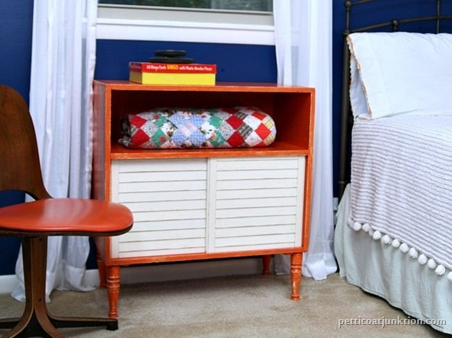 orange furniture pops against a blue wall Petticoat Junktion