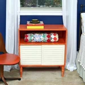 Orange Furniture Pops Against A Blue Wall