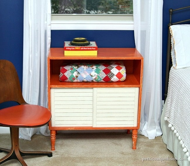 orange furniture pops against blue walls Petticoat Junktion