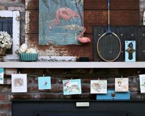 pink-flamingo-mantel-with-vintage-card-garland-Petticoat-Junktion.jpg