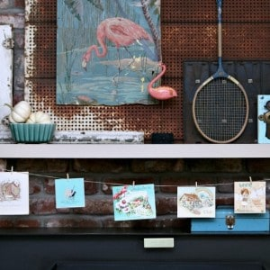 pink-flamingo-mantel-with-vintage-card-garland-Petticoat-Junktion.jpg