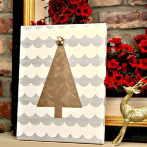 silver and gold metallic Christmas tree wall decor using Frogtape ShapeTape