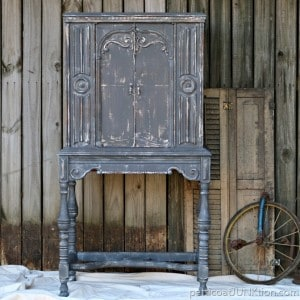 The gray cabinet with white details