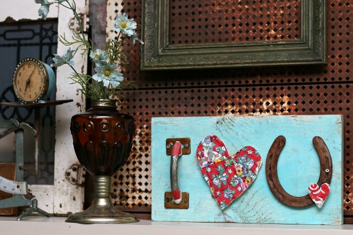 make an I love you sign from recycled items
