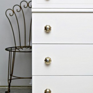 White Drawers Decorated With Gold Mercury Glass Bling